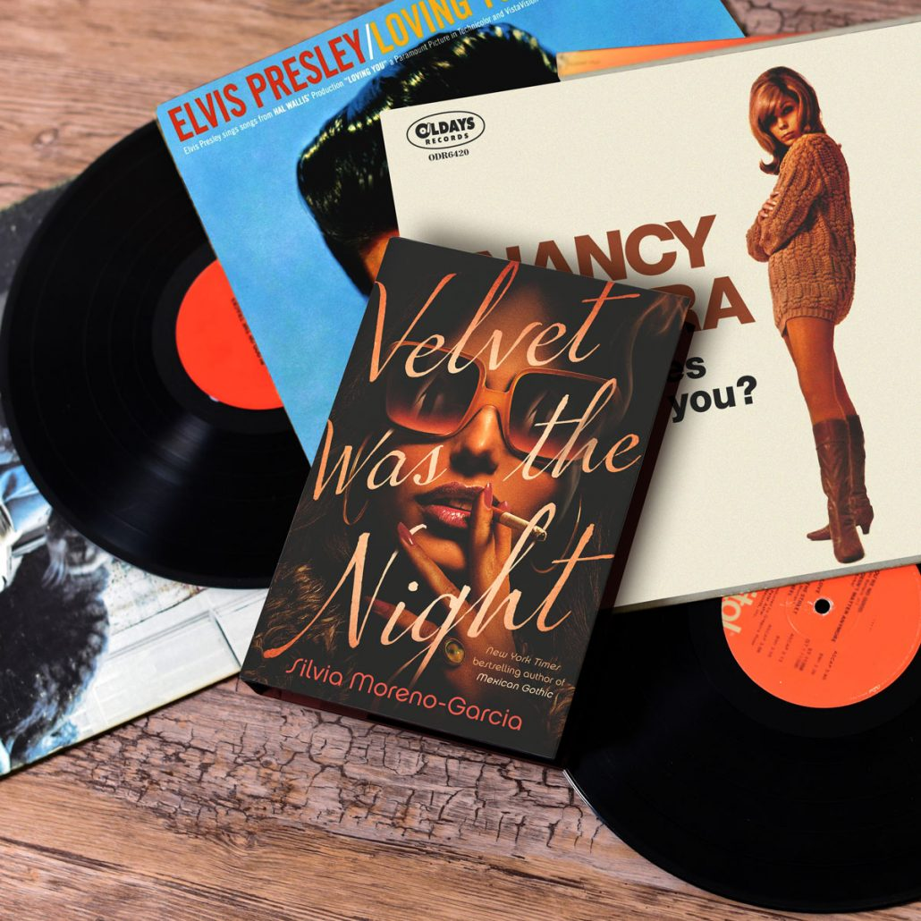 Cover Velvet Was the Night with records around it